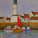 Vissersboot met rood zeil